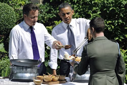 US President Barack Obama and UK PM David Cameron serving burgers