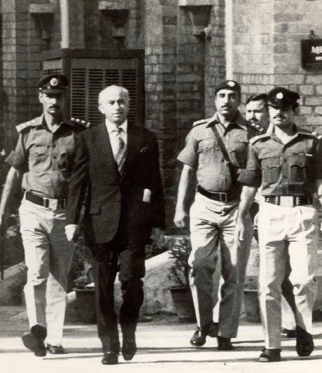 Zulfikar Ali Bhutto being walked to court