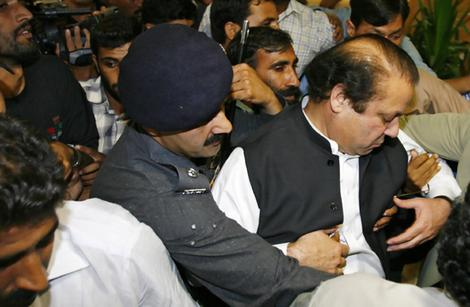 Former Pakistani prime minister Sharif is arrested upon is arrival at Islamabad's airport