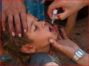 Polio drops given to a child