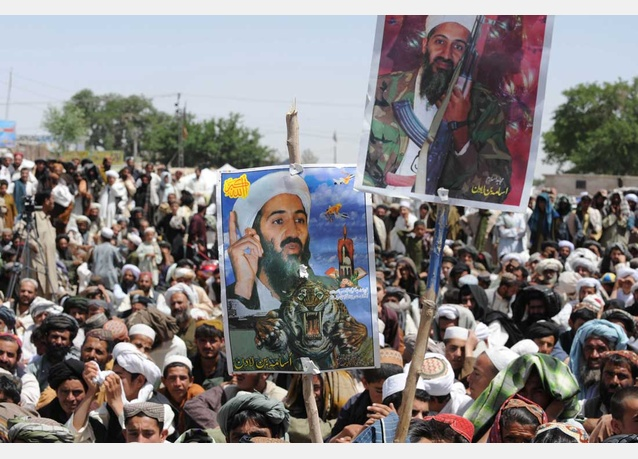 Pakistani protestors holding posters of Osama bin Laden