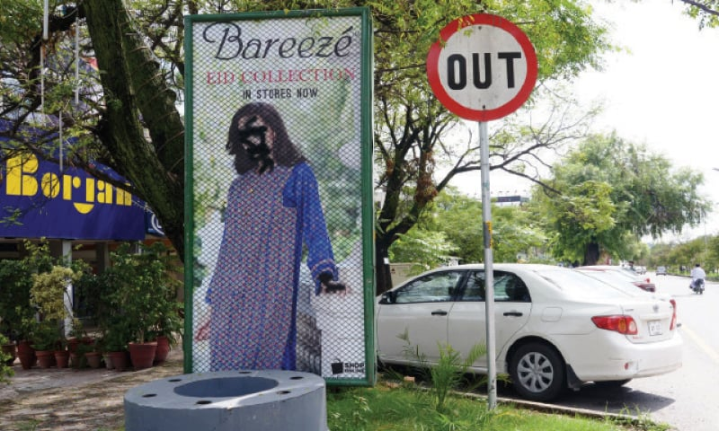 Morality brigades deface billboards in Islamabad